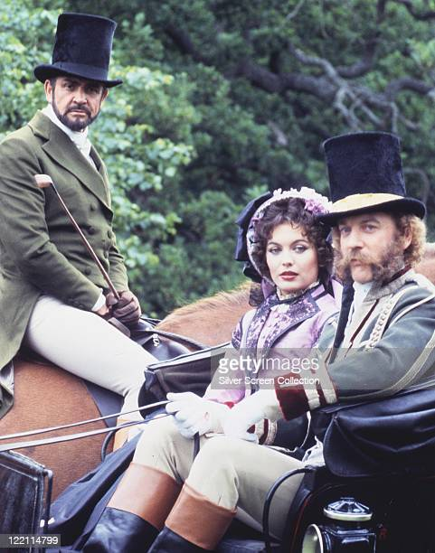 Sean Connery British actor on horseback with LesleyAnne Down British actress and Donald Sutherland Canadian actor riding in a carriage all dressed in...