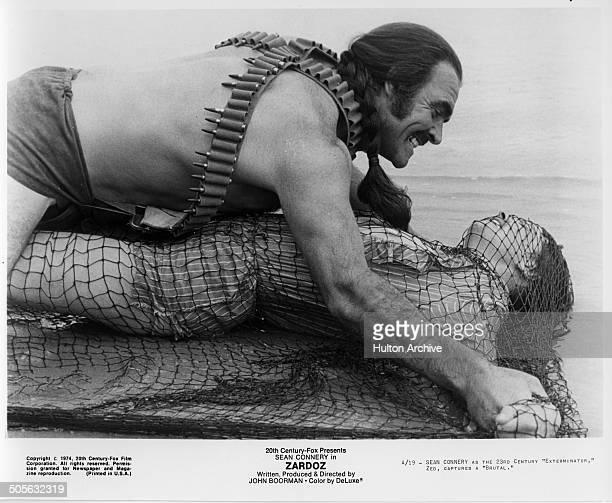 Sean Connery captures a woman in a scene from the 20th Century Fox movie 'Zardoz' circa 1974