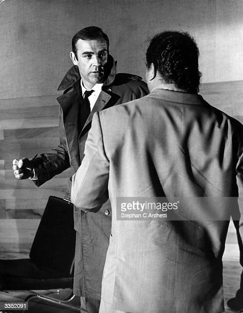 Sean Connery is James Bond under attack from an enemy henchman in a scene from the film 'You Only Live Twice'