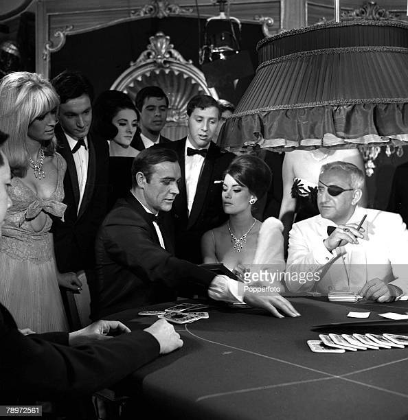1965 Sean Connery is pictured during the making of the James Bond film 'Thunderball' The scene is set in a casino where Bond is playing cards with...