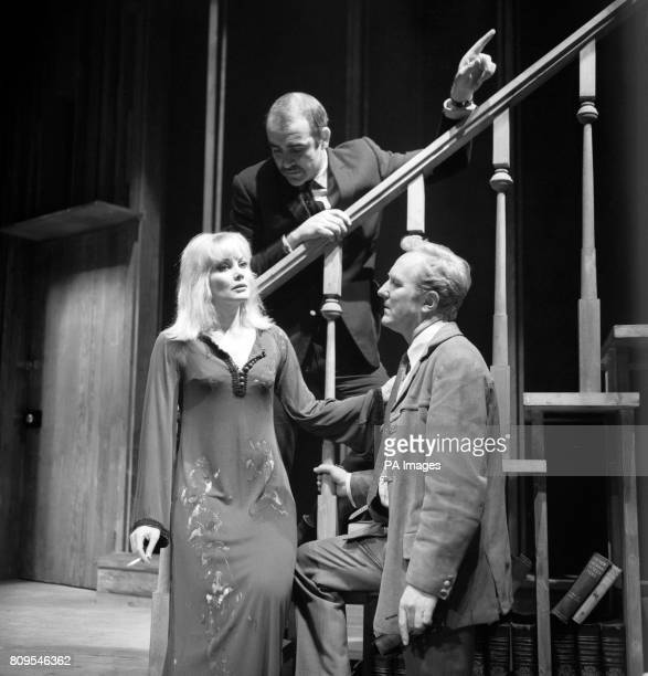 Sean Connery making his West End debut as a director indicates the action he wants from his wife Diane Cilento and Robert Hardy in a scene from 'I've...