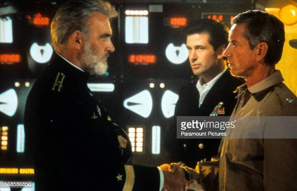 Sean Connery shakes hands with Scott Glenn watched by Alec Baldwin in a scene from the film 'The Hunt For Red October' 1990