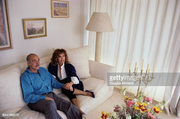 Sean Connery sits cozy at his home on the sofa with his wife Micheline
