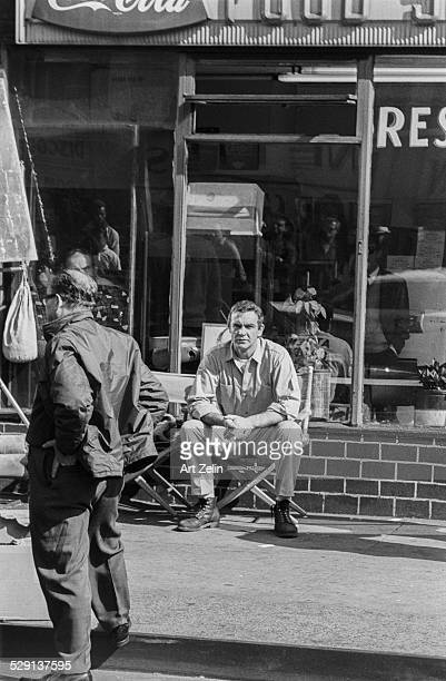 Sean Connery sitting in a directors chair on a movie set outside circa 1970 New York
