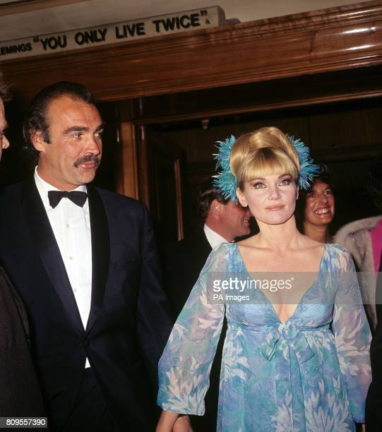Sean Connery who plays James Bond in 'You Only Live Twice' arriving with his wife actress Diane Cilento for the premiere of the film at the Odeon...