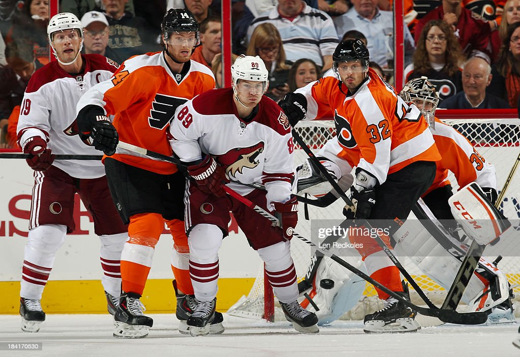 <a gi-track='captionPersonalityLinkClicked' href=/galleries/search?phrase=Sean+Couturier&family=editorial&specificpeople=5663953 ng-click='$event.stopPropagation()'>Sean Couturier</a> #14 and <a gi-track='captionPersonalityLinkClicked' href=/galleries/search?phrase=Mark+Streit&family=editorial&specificpeople=636976 ng-click='$event.stopPropagation()'>Mark Streit</a> #32 of the Philadelphia Flyers defend goaltender Steve Mason #35 against <a gi-track='captionPersonalityLinkClicked' href=/galleries/search?phrase=Shane+Doan&family=editorial&specificpeople=201614 ng-click='$event.stopPropagation()'>Shane Doan</a> #19 and <a gi-track='captionPersonalityLinkClicked' href=/galleries/search?phrase=Mikkel+Boedker&family=editorial&specificpeople=4697252 ng-click='$event.stopPropagation()'>Mikkel Boedker</a> #89 of the Phoenix Coyotes on October 11, 2013 at the Wells Fargo Center in Philadelphia, Pennsylvania. The Coyotes went on to defeat the Flyers 2-1.