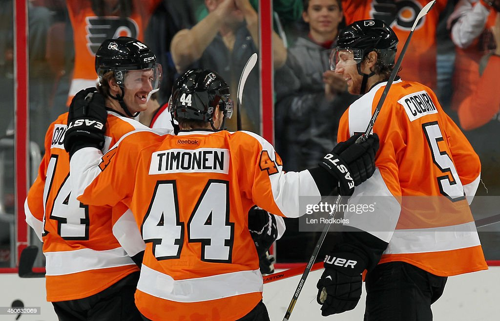 Sean Couturier #14, Kimmo Timonen #44 and Braydon Coburn #5 of the Philadelphia Flyers celebrate Couturier's second period goal against the Ottawa Senators on November 19, 2013 at the Wells Fargo Center in Philadelphia, Pennsylvania. The goal was Couturier's first of the season.