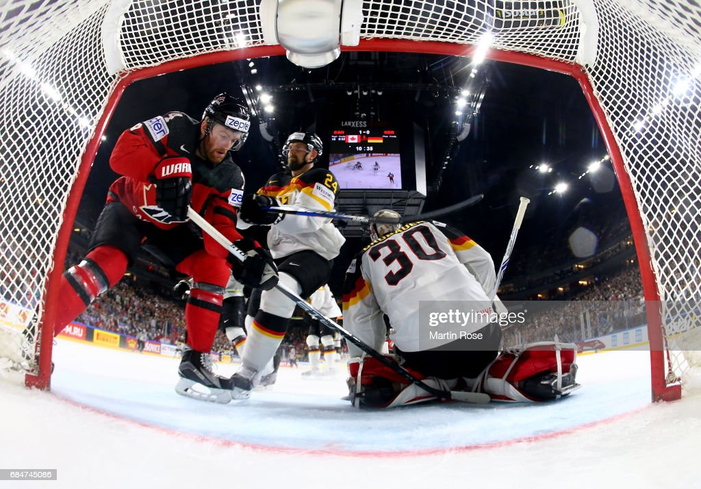 Sean Couturier (L) of Canada fails to score over Philipp Grubauer, goaltender of Germany during the 2017 IIHF Ice Hockey World Championship quarter final game between Canada and Germany at Lanxess Arena on May 18, 2017 in Cologne, Germany.