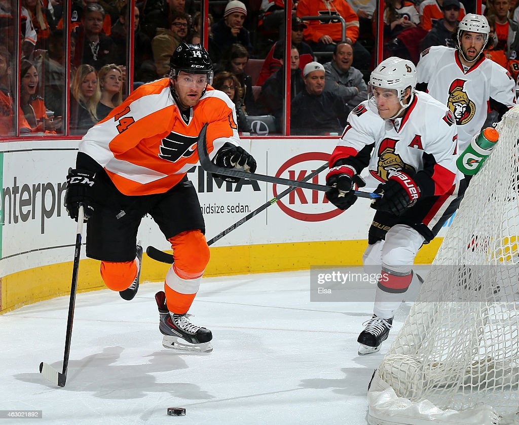 Sean Couturier #14 of the Philadelphia Flyers and Kyle Turris #7 of the Ottawa Senators fight for the puck on January 6, 2015 at the Wells Fargo Center in Philadelphia, Pennsylvania.