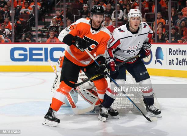 Sean Couturier of the Philadelphia Flyers battles against TJ Oshie of the Washington Capitals on October 14 2017 at the Wells Fargo Center in...