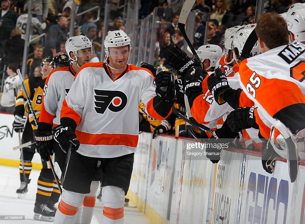 Sean Couturier of the Philadelphia Flyers celebrates his empty net goal during the third period against the Pittsburgh Penguins at Consol Energy...