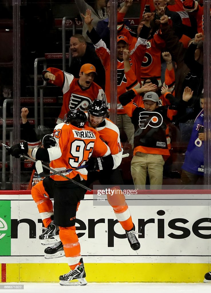 Sean Couturier #14 of the Philadelphia Flyers celebrates his goal with teammate Jakub Voracek #93 in the third period to tie the game against the Arizona Coyotes on October 30, 2017 at Wells Fargo Center in Philadelphia, Pennsylvania.