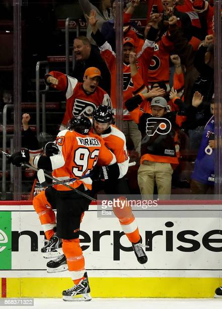 Sean Couturier of the Philadelphia Flyers celebrates his goal with teammate Jakub Voracek in the third period to tie the game against the Arizona...