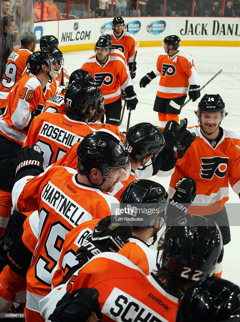 Sean Couturier #14 of the Philadelphia Flyers celebrates his second-period goal against the Ottawa Senators with his teammates on November 19, 2013 at the Wells Fargo Center in Philadelphia, Pennsylvania. The goal was Couturier's first of the season. The Flyers went on to defeat the Senators 5-2.