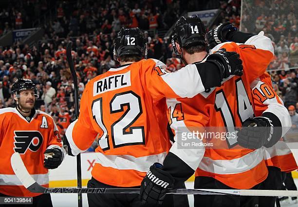 Sean Couturier of the Philadelphia Flyers celebrates his third period goal with teammates Brayden Schenn Michael Raffl and Mark Streit against the...