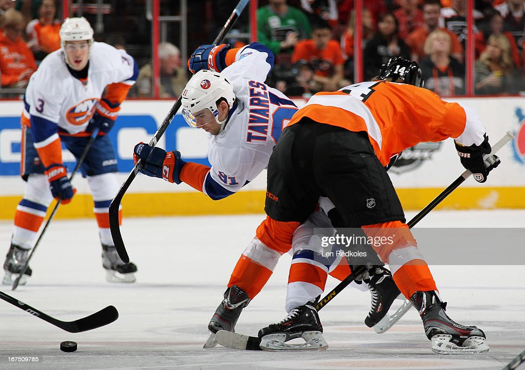 <a gi-track='captionPersonalityLinkClicked' href=/galleries/search?phrase=Sean+Couturier&family=editorial&specificpeople=5663953 ng-click='$event.stopPropagation()'>Sean Couturier</a> #14 of the Philadelphia Flyers faces off against <a gi-track='captionPersonalityLinkClicked' href=/galleries/search?phrase=John+Tavares&family=editorial&specificpeople=601791 ng-click='$event.stopPropagation()'>John Tavares</a> #91 of the New York Islanders in the first period on April 25, 2013 at the Wells Fargo Center in Philadelphia, Pennsylvania.