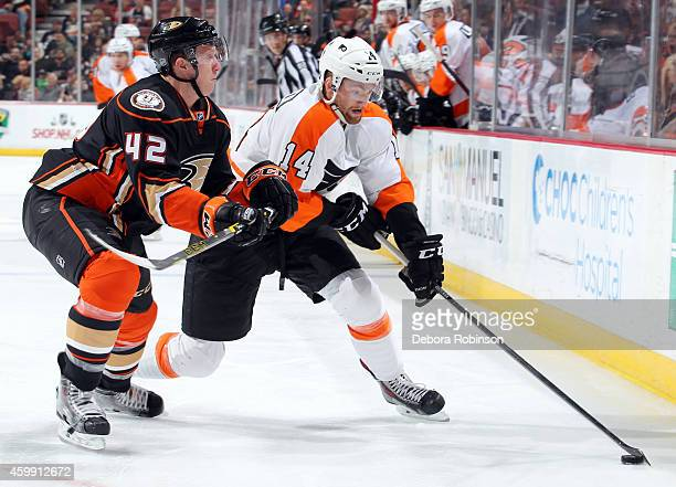 Sean Couturier of the Philadelphia Flyers handles the puck against Josh Manson of the Anaheim Ducks on December 3 2014 at Honda Center in Anaheim...