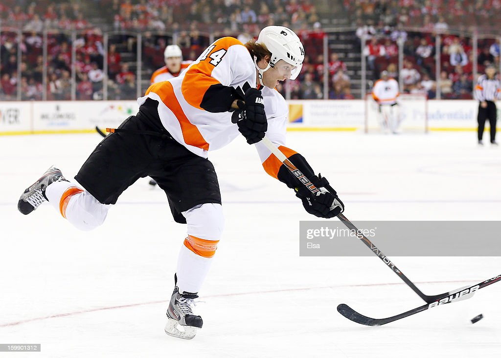 <a gi-track='captionPersonalityLinkClicked' href=/galleries/search?phrase=Sean+Couturier&family=editorial&specificpeople=5663953 ng-click='$event.stopPropagation()'>Sean Couturier</a> #14 of the Philadelphia Flyers passes the puck in the third period against the New Jersey Devils during the season opener at the Prudential Center on January 22, 2013 in Newark, New Jersey.The New Jersey Devils shut out the Philadelphia Flyers 3-0.