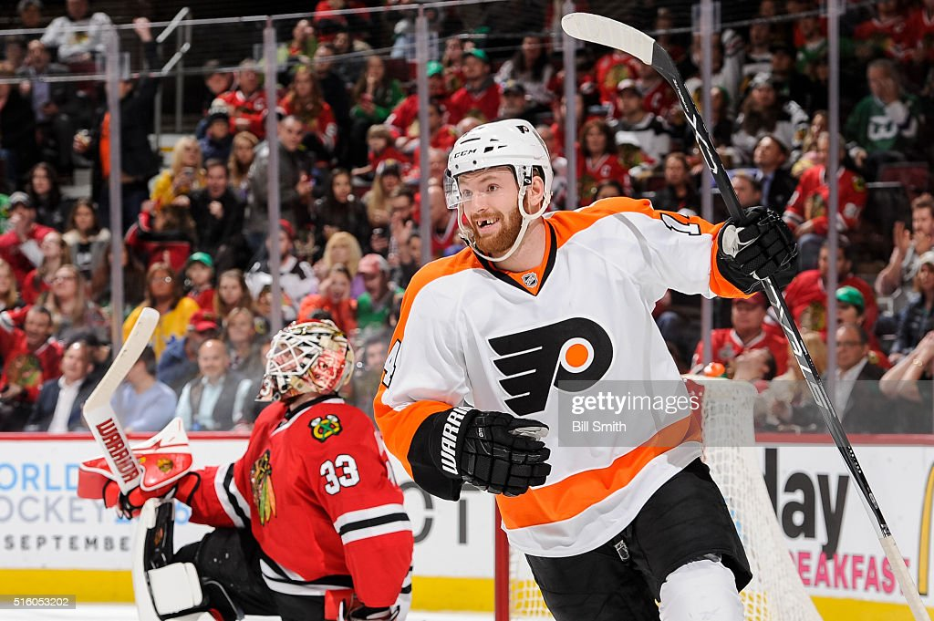 Sean Couturier #14 of the Philadelphia Flyers reacts after assisting in scoring on goalie Scott Darling #33 of the Chicago Blackhawks in the third period of the NHL game at the United Center on March 16, 2016 in Chicago, Illinois.