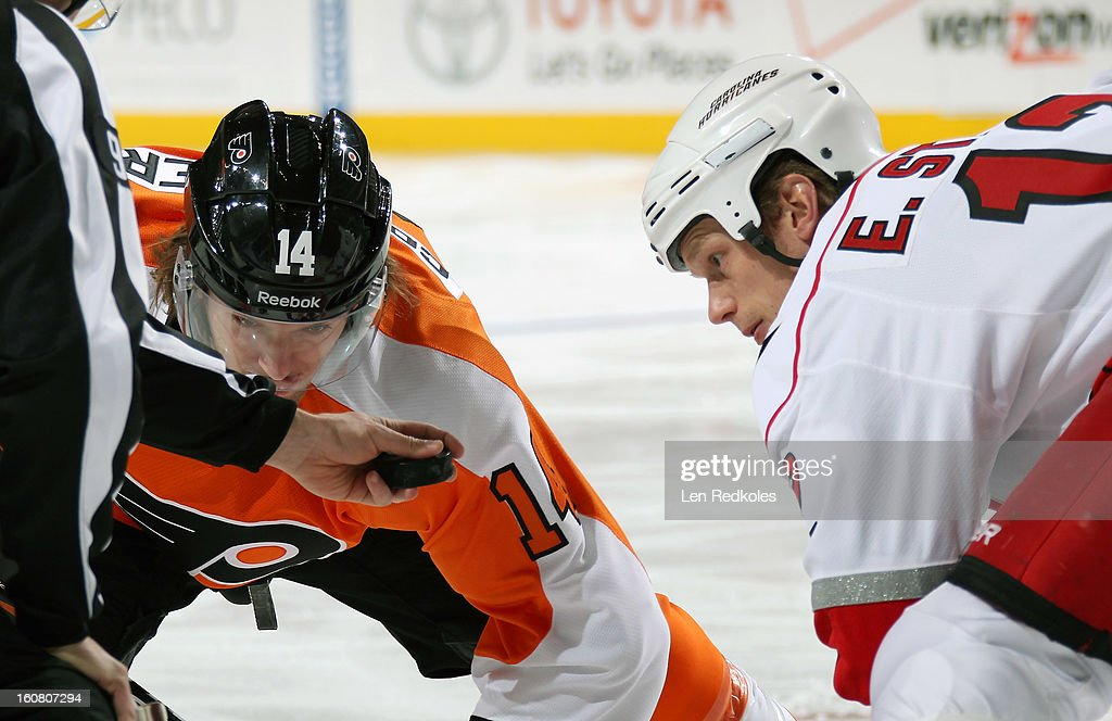 Sean Couturier #14 of the Philadelphia Flyers readies to face-off against Eric Staal #12 of the Carolina Hurricanes on February 2, 2013 at the Wells Fargo Center in Philadelphia, Pennsylvania.