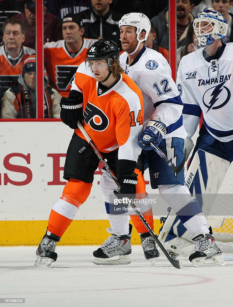 Sean Couturier of the Philadelphia Flyers sets up in front of Ryan Malone and Anders Lindback of the Tampa Bay Lightning on February 5 2013 at the...