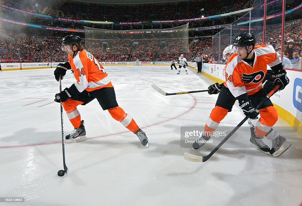 <a gi-track='captionPersonalityLinkClicked' href=/galleries/search?phrase=Sean+Couturier&family=editorial&specificpeople=5663953 ng-click='$event.stopPropagation()'>Sean Couturier</a> #14 of the Philadelphia Flyers skates away with the puck from teammate <a gi-track='captionPersonalityLinkClicked' href=/galleries/search?phrase=Matt+Read&family=editorial&specificpeople=6783206 ng-click='$event.stopPropagation()'>Matt Read</a> #24 during the game against the Pittsburgh Penguins at the Wells Fargo Center on March 7, 2013 in Philadelphia, Pennsylvania.