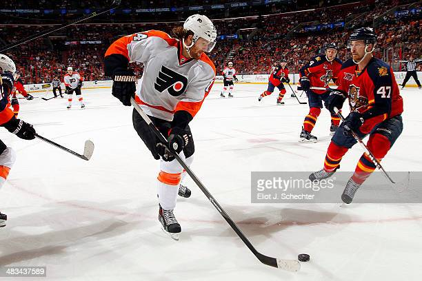 Sean Couturier of the Philadelphia Flyers skates with the puck against Colby Robak of the Florida Panthers at the BBT Center on April 8 2014 in...