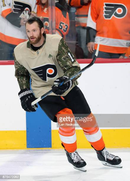 Sean Couturier of the Philadelphia Flyers wearing a camouflage jersey in honor of Military Appreciation night warms up against the Minnesota Wild on...