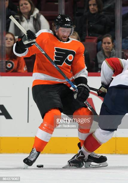 Sean Couturier of the Philadelphia Flyers wins control of the puck on a faceoff against the Florida Panthers on October 17 2017 at the Wells Fargo...