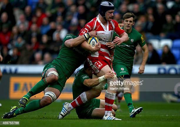 Sean Cox and Fergus Mulchrone of London Irish combine to tackle Tom Savage of Gloucester during the Aviva Premiership match between London Irish and...
