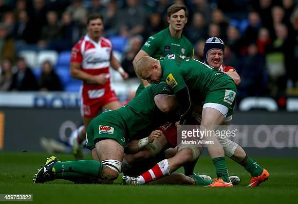 Sean Cox Fergus Mulchrone and Tom Homer of London Irish combine to tackle Tom Savage of Gloucester during the Aviva Premiership match between London...