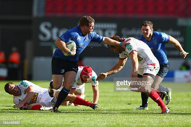 Sean Cronin of Leinster holds off Andy Fenby of Scarlets during the Heineken Cup Pool 5 match between Scarlets and Leinster at Parc y Scarlets on...