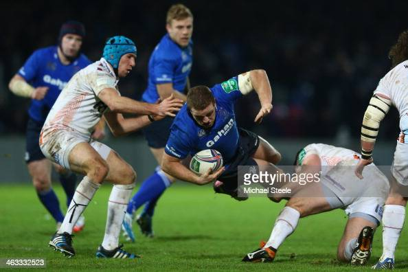 Sean Cronin of Leinster is tackled by Ryan Bevington of Ospreys as Justin Tipuric closes in during the Heineken Cup Pool One match between |Leinster...
