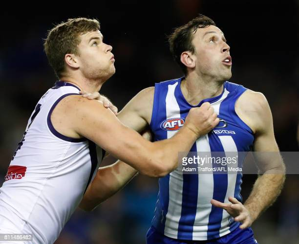 Sean Darcy of the Dockers and Todd Goldstein of the Kangaroos compete in a ruck contest during the 2017 AFL round 16 match between the North...