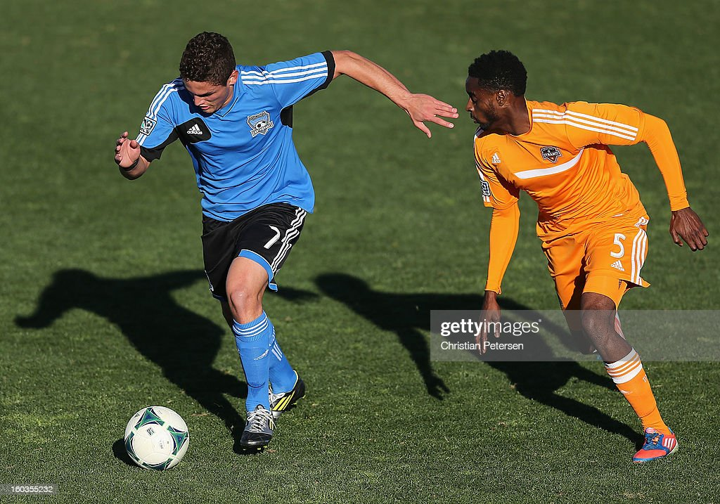 Sean Dasilva #7 (L) of the San Jose Earthquakes moves the ball past Warren Creavalle #5 of the Houston Dynamo during The Desert Friendlies Presented By FC Tucson at Kino Sports Complex on January 29, 2013 in Tucson, Arizona. The Earthquakes defeated the Dynamo 2-0.