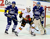 Sean Day and Jacob Brennan of the Mississauga Steelheads keep an eye on the play with Andrew Ming of the Belleville Bulls during OHL game action on...