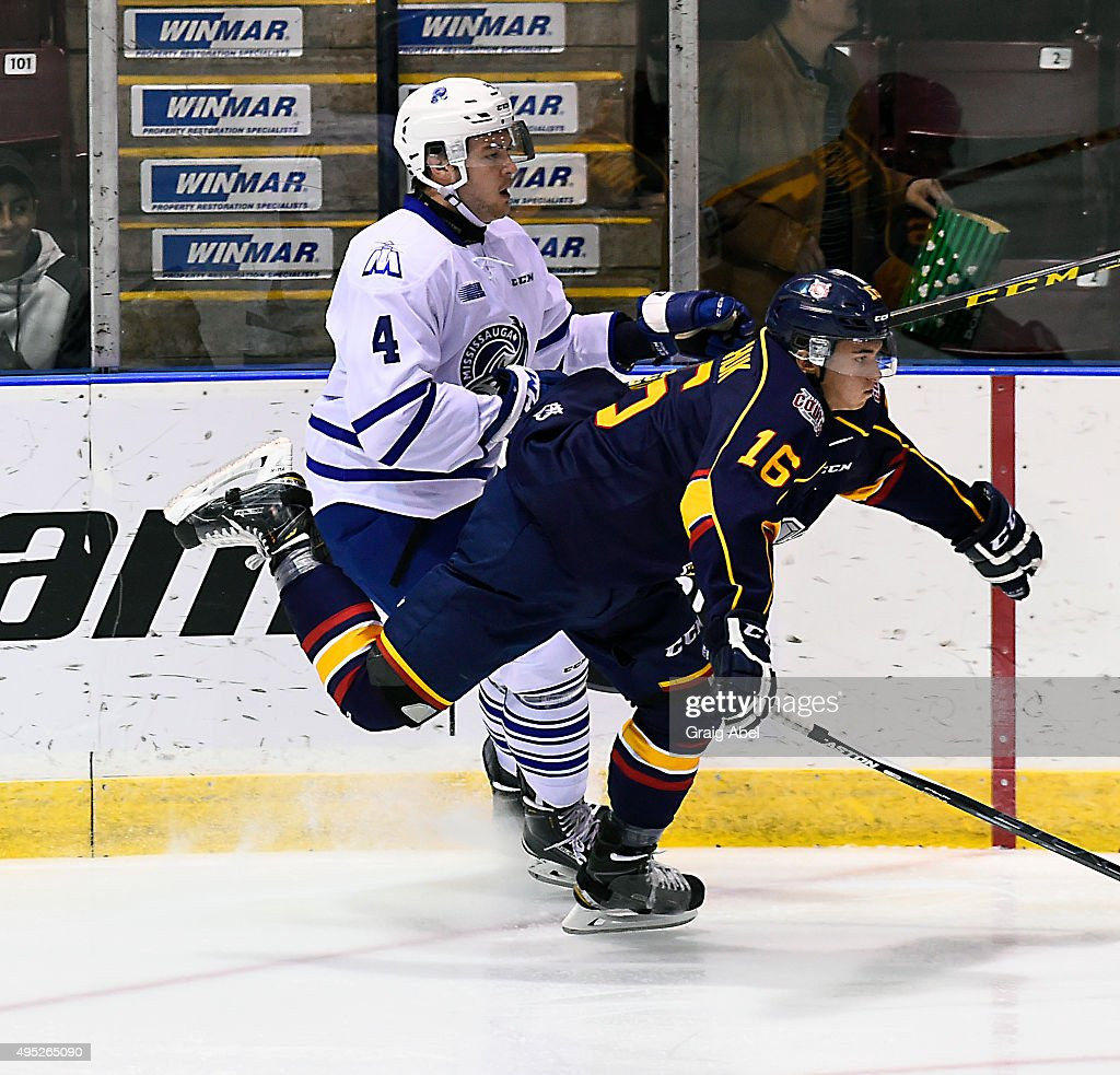 Sean Day #4 of the Mississauga Steelheads controls Ben Hawerchuk #16 of the Barrie Colts during OHL game action on November 1, 2015 at the Hershey Centre in Mississauga, Ontario, Canada.