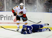 Sean Day of the Mississauga Steelheads is taken down by Niki Petti of the Belleville Bulls during OHL game action on January 16 2015 at the Hershey...