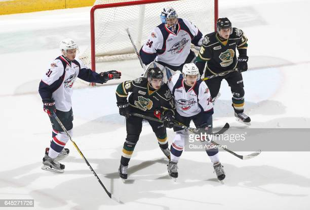 Sean Day of the Windsor Spitfires skates against Liam Foudy of the London Knights during an OHL game at Budweiser Gardens on February 24 2017 in...