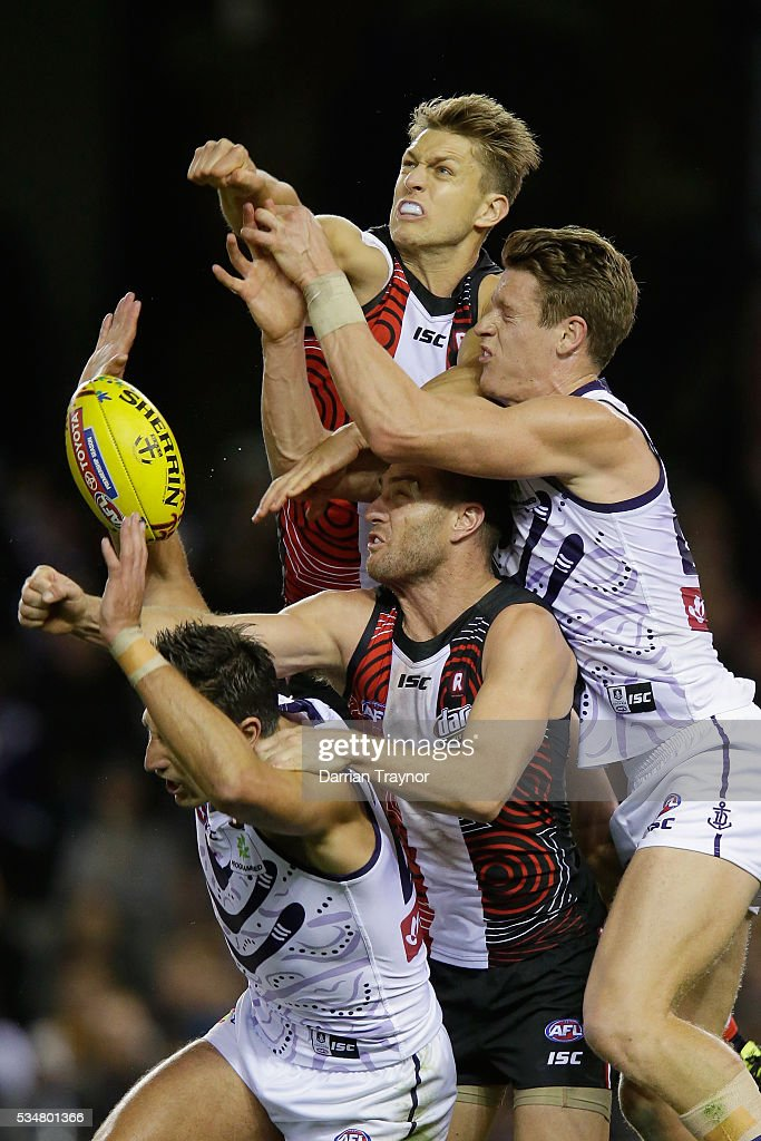 Sean Dempster of the Saints spoils the ball over team mate Sam Fisher and <a gi-track='captionPersonalityLinkClicked' href=/galleries/search?phrase=Matthew+Pavlich&family=editorial&specificpeople=208649 ng-click='$event.stopPropagation()'>Matthew Pavlich</a> of the Dockers during the round 10 AFL match between the St Kilda Saints and the Fremantle Dockers at Etihad Stadium on May 28, 2016 in Melbourne, Australia.