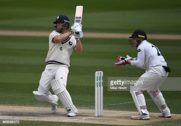 Sean Dickson of Kent hits a boundary as wicketkeeper Ben Brown of Sussex looks on during day three of the Specsavers County Championship Division Two...