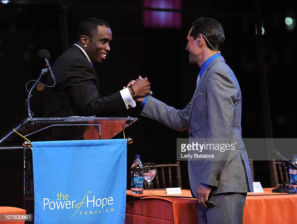 Sean 'Diddy' Combs and musician El DeBarge speak onstage at City Of Hope's Music and Entertainment Industry Presents The Roast Of Stephen Hill at...