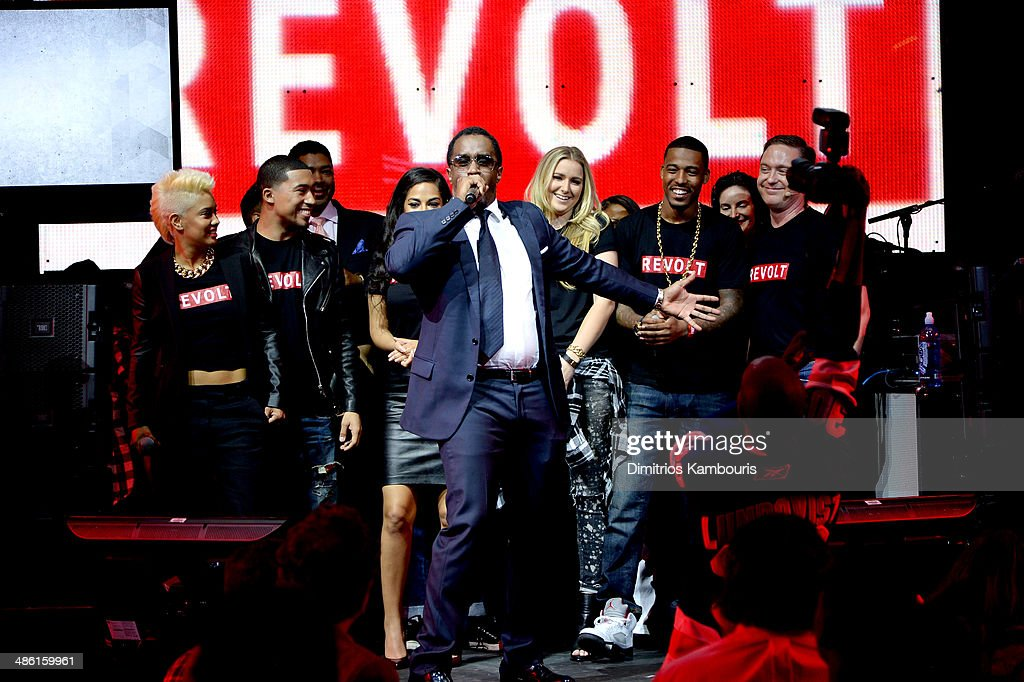 Sean 'Diddy' combs and the REVOLT Team attend the REVOLT TV First Annual Upfront presentation at Marquee on April 22, 2014 in New York City.