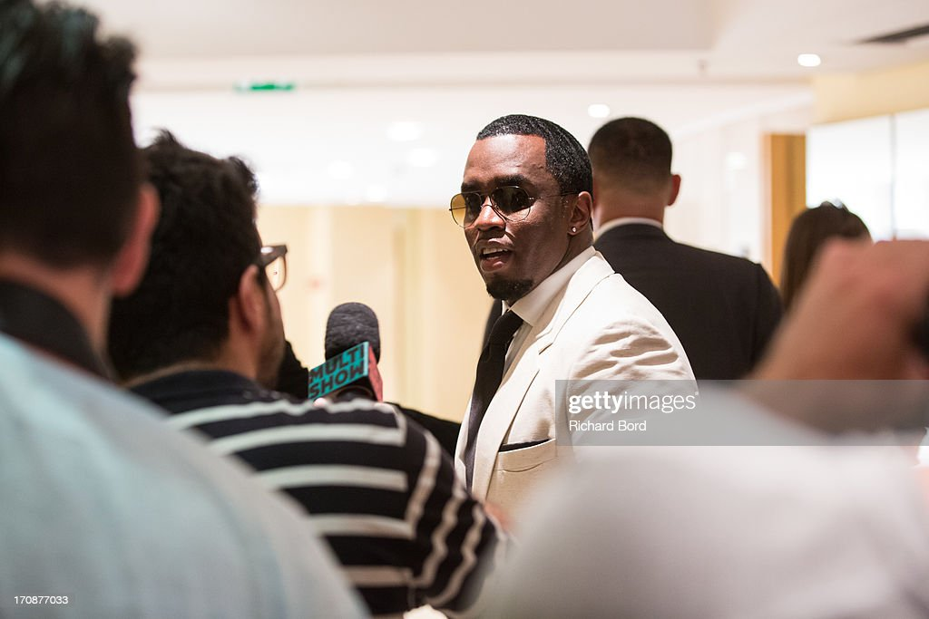 Sean 'Diddy' Combs is surrounded by journalists after the 'Culture as a Creative Catalyst' Seminar at the Palais des Festivals during the 60th Cannes Lions International Festival of Creativity on June 19, 2013 in Cannes, France.