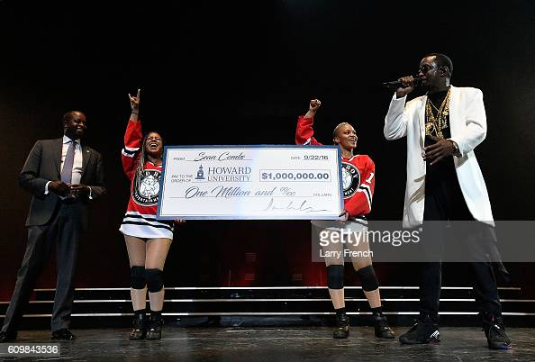 Sean 'Diddy' Combs presents his Alma Matter Howard University's President Wayne AI Frederick MD MBA with one million dollar check at the Puff Daddy...