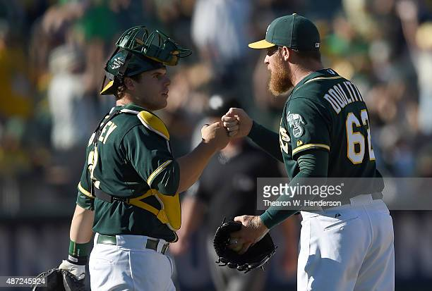 Sean Doolittle and Josh Phegley of the Oakland Athletics celebrates defeating the Houston Astros 109 at Oco Coliseum on September 7 2015 in Oakland...