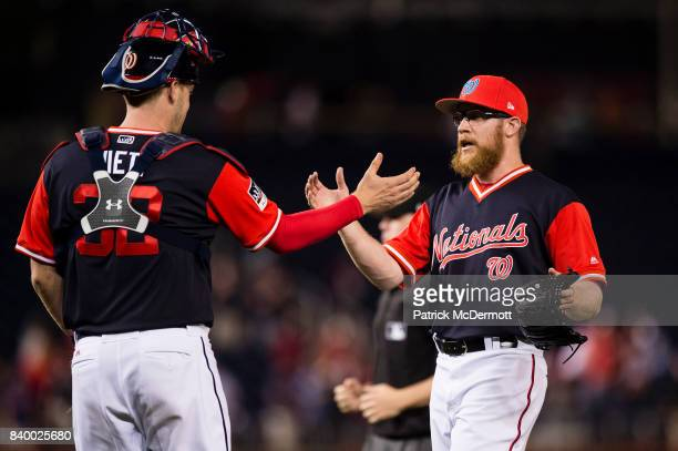 Sean Doolittle and Matt Wieters of the Washington Nationals celebrate after the Nationals defeated the New York Mets 54 during Game Two of a...