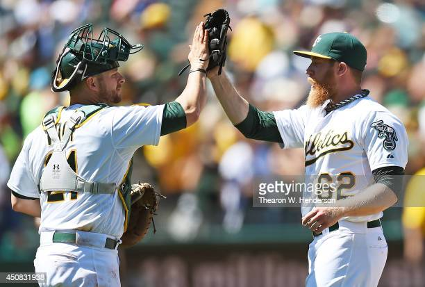 Sean Doolittle and Stephen Vogt of the Oakland Athletics celebrate defeating the Texas Rangers 42 at Oco Coliseum on June 18 2014 in Oakland...