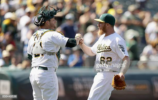 Sean Doolittle and Stephen Vogt of the Oakland Athletics high five after they beat the Detroit Tigers at the Coliseum on May 29 2016 in Oakland...
