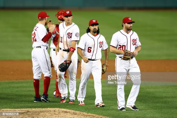 Sean Doolittle celebrates with Pedro Severino of the Washington Nationals after defeating the Milwaukee Brewers at Nationals Park on Wednesday July...